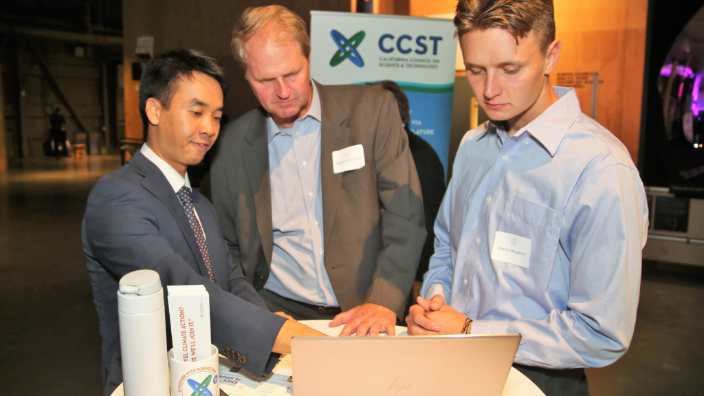 "University of Southern California doctoral student Brian Y. An explains his research on the diffusion of climate policies across Southern California municipalities.  The California Council on Science and Technology (CCST) hosted the CCST Climate Science Translators Showcase on Tuesday, September 11, 2018 at the Exploratorium as an Affiliate Event of the historic Global Climate Action Summit in San Francisco — held during the ""Celebration of Science and Education"" reception hosted by the Governor's Office of Planning and Research (OPR), CCST, the Gordon and Betty Moore Foundation, CalEPA, and Ten Strands. The #CCSTShowcase recruited and trained 12 graduate students and postdocs from California universities and research institutions to communicate their climate-related research to policy leaders, staff, and other Summit delegates."