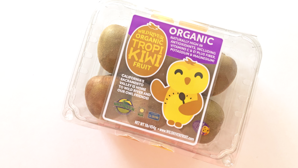 "Our Owl Friends and associated kiwi owl logos are trademarks of Wild River Marketing Inc. Designed by Ben Young Landis and Guy Rogers. The photo shows a plastic clamshell container with six Tropikiwi kiwifruits inside. The container's graphic shows the smiling Wild River gold kiwi owl with one wing holding a spoon. Graphic says ""California's Sacramento Valley is home to Wild River and Our Owl Friends!"" and that the fruits are organic, naturally high in antioxidants, including vitamins C & E! Plus fiber, potassium & magnesium!"